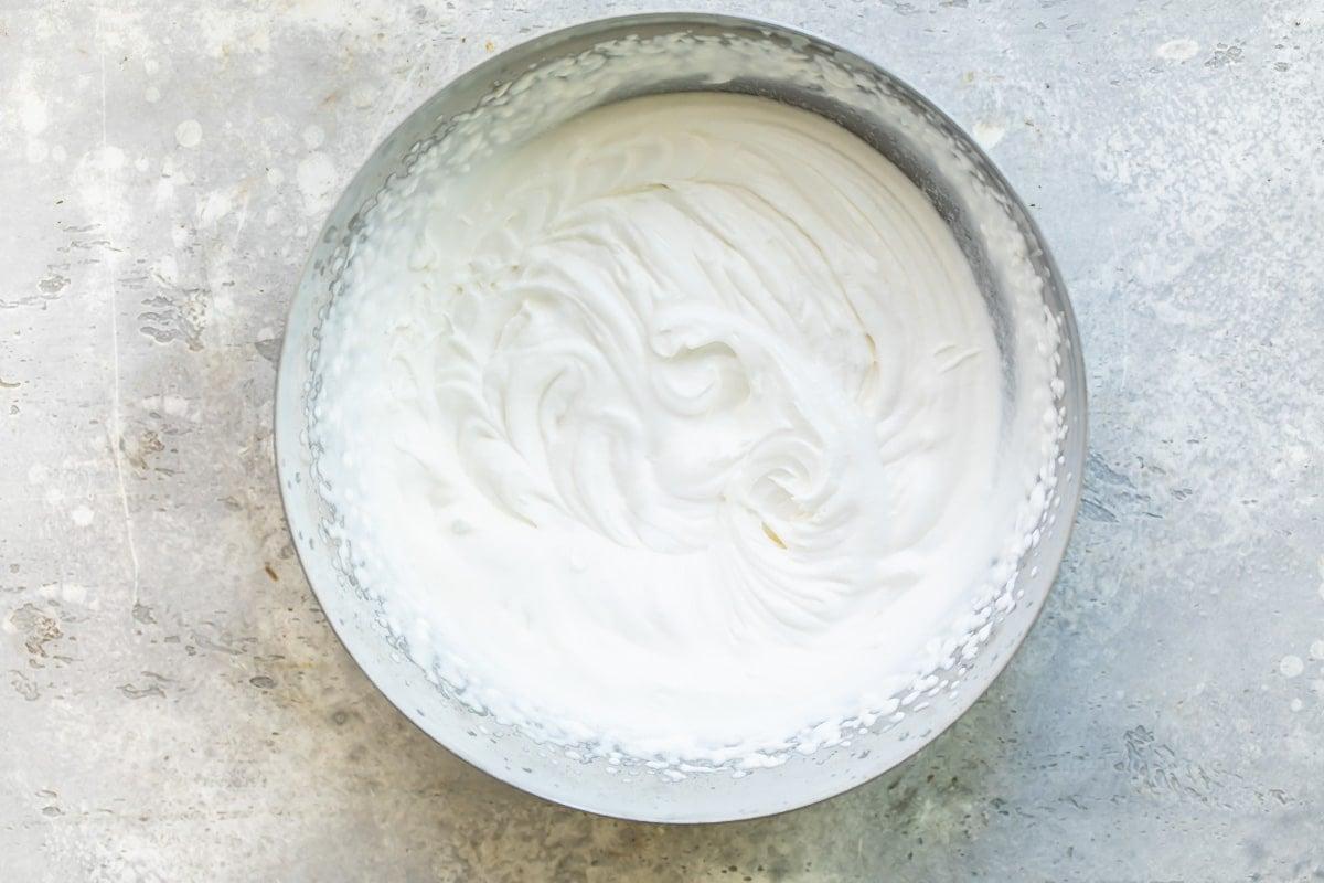 Cream beaten to soft peaks.