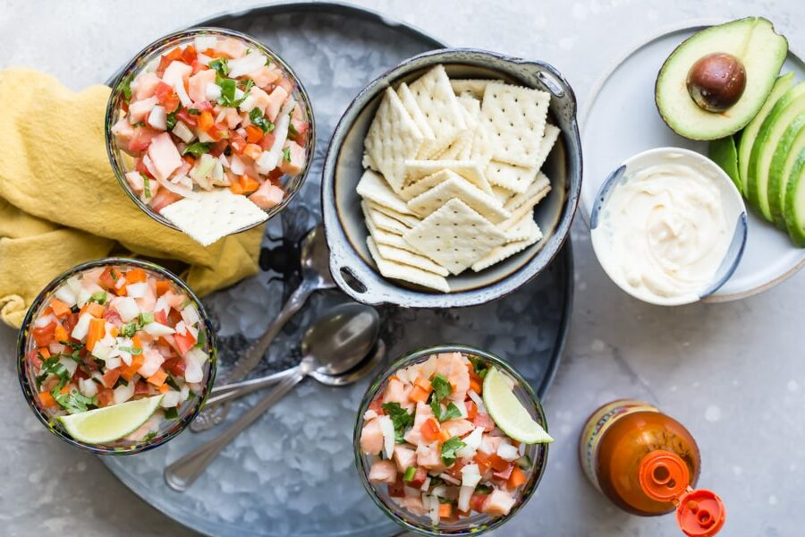 An overhead shot of salmon ceviche in stemmed glasses.