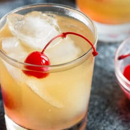 A whiskey sour in a rocks glass.