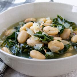 White bean and kale soup in a bowl.