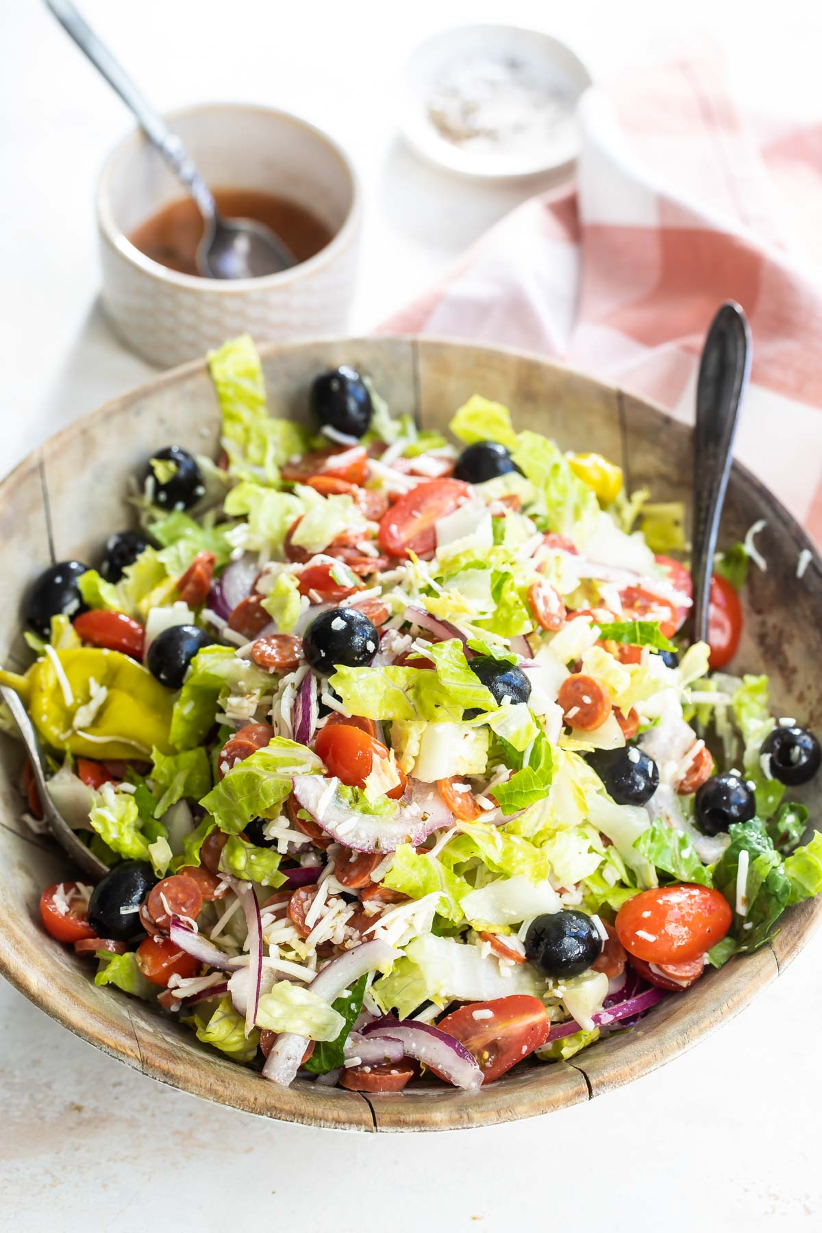 Antipasto salad mixed in a wooden bowl.