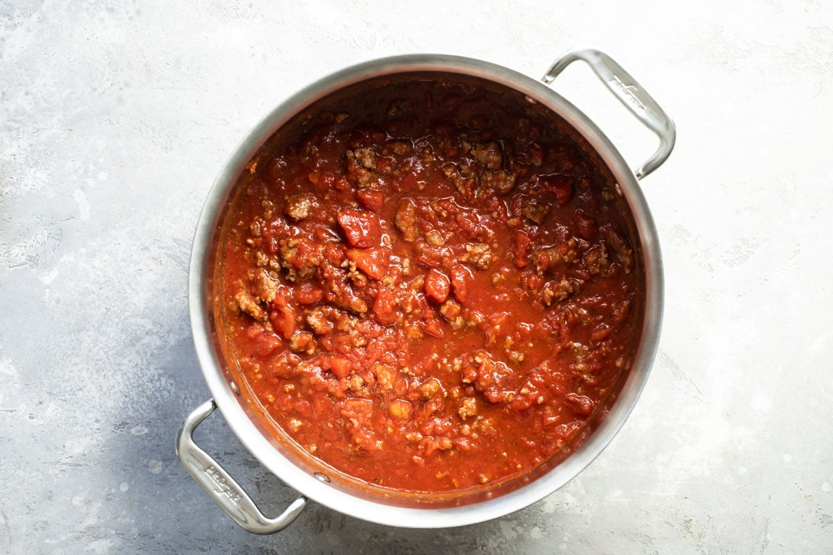 Meat sauce in a silver skillet.