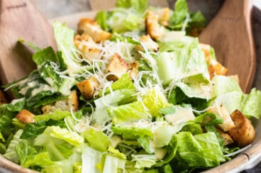Caesar salad in a wooden bowl.