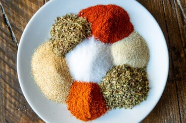 Cajun seasoning spices on a white plate.