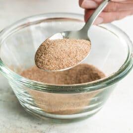 A bowl of cinnamon sugar topping.