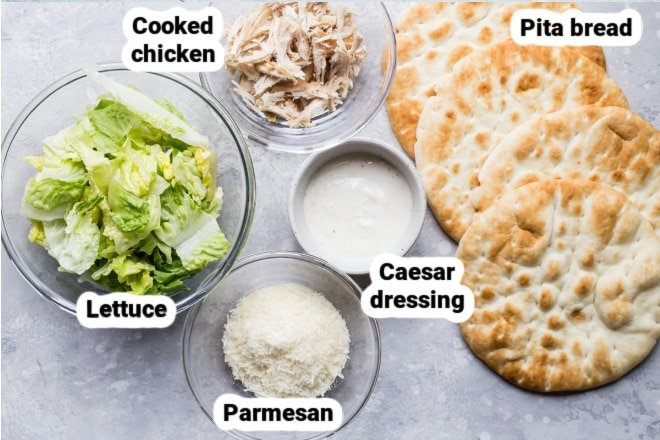 Labeled Grilled Chicken Caesar Wrap ingredients in various bowls.