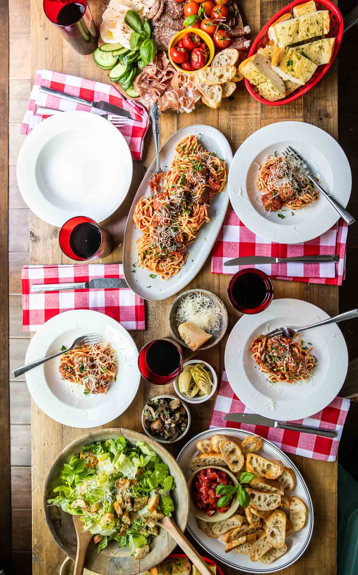 A spread of Italian food on a wooden table.