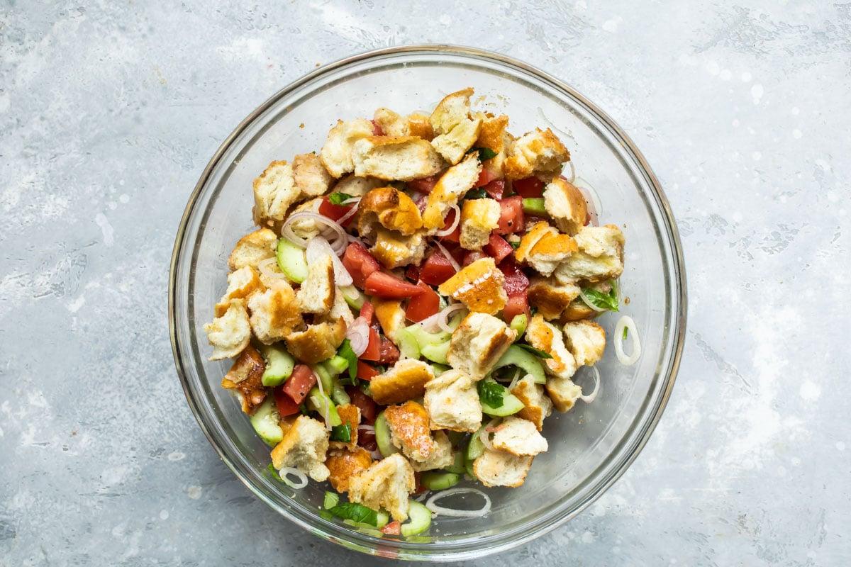 Panzanella salad in a clear bowl.