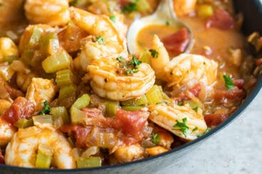 Shrimp creole in a black bowl.