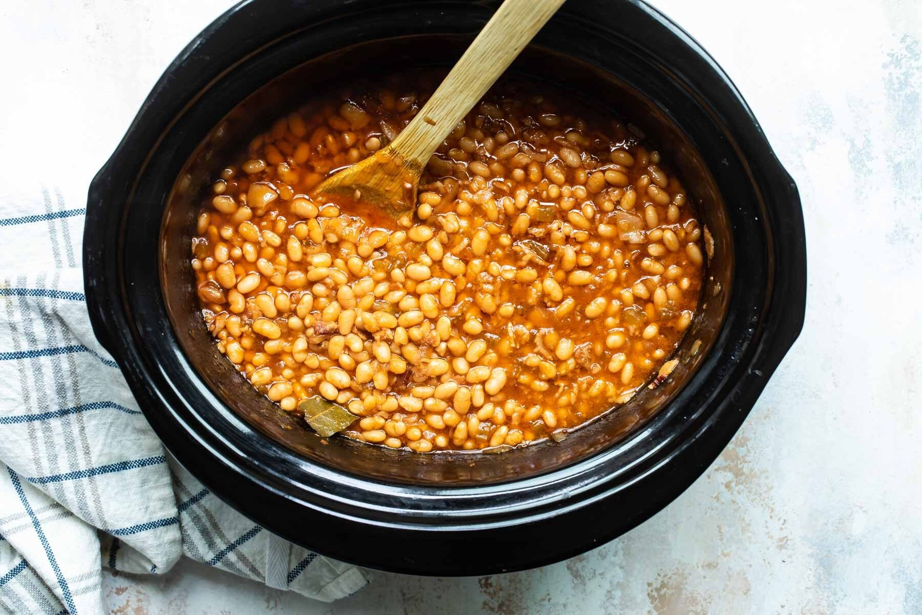 Homemade baked beans in a slow cooker.