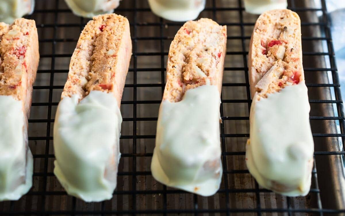 Cherry almond biscotti on a cooling rack.