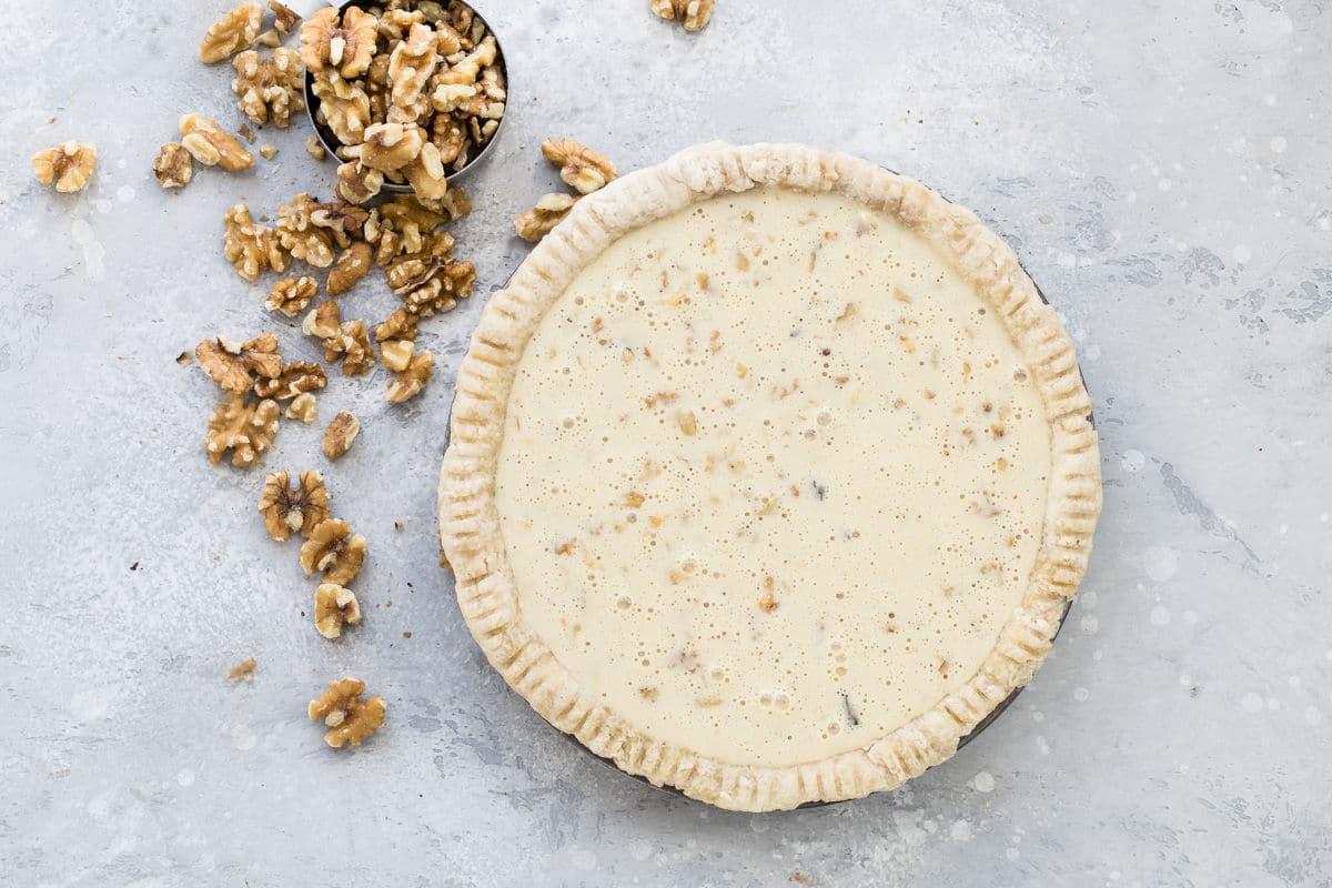 A chocolate walnut pie before baking.