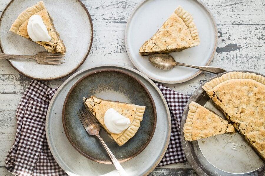 Slices of chocolate walnut pie on plates.
