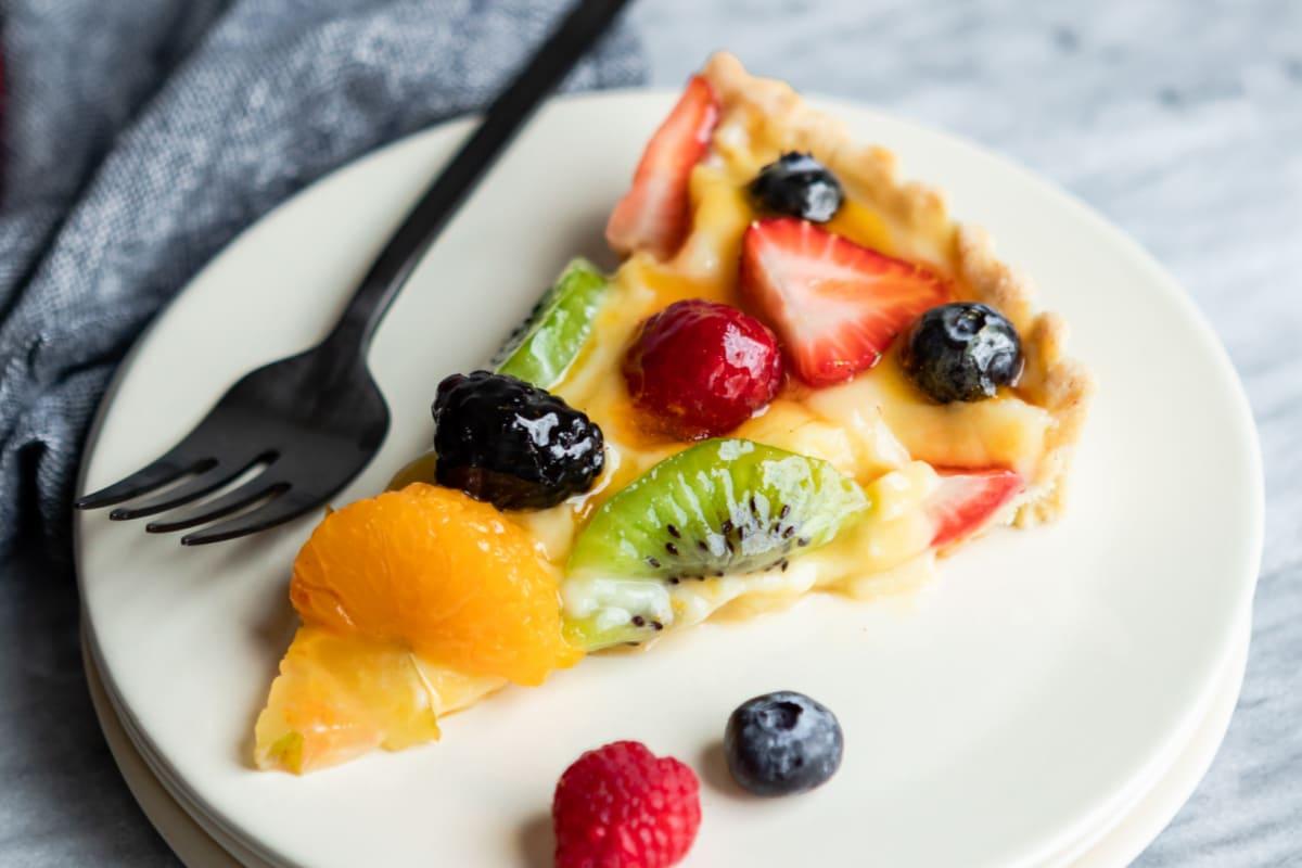 A slice of fresh fruit tart.