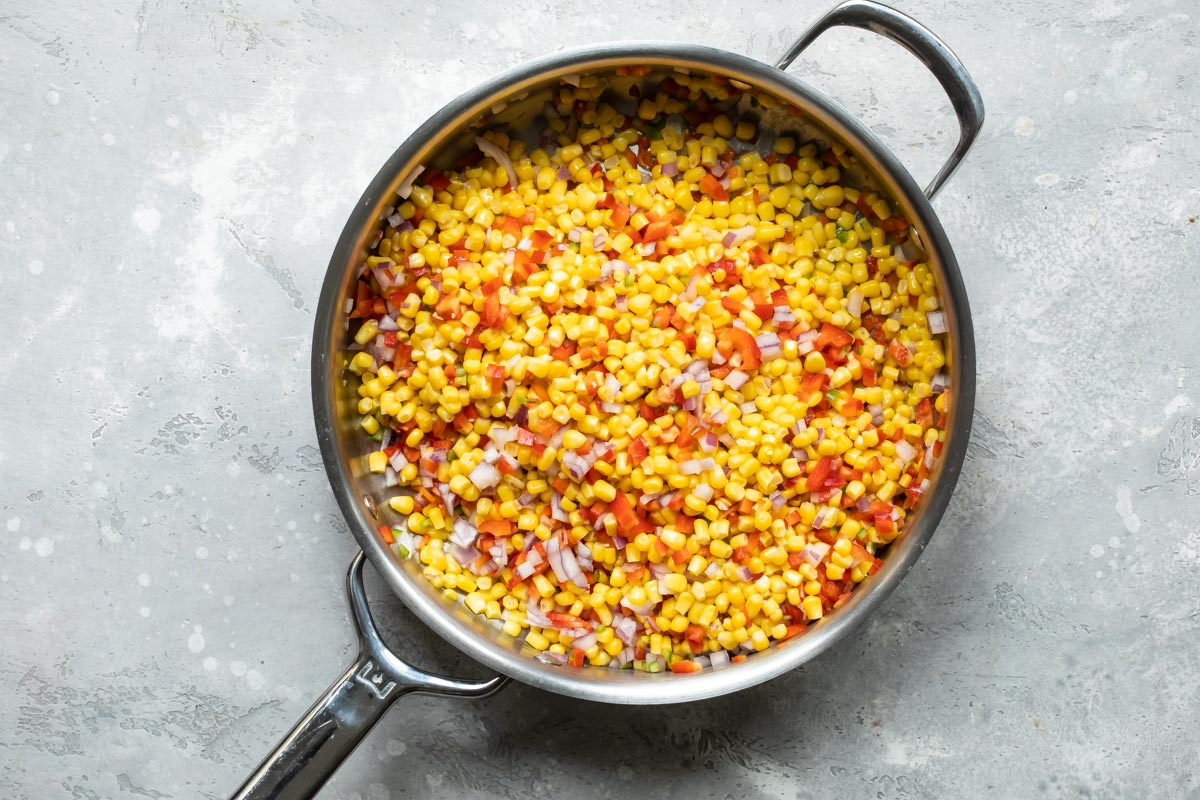 Cooking corn and peppers for hot corn dip.