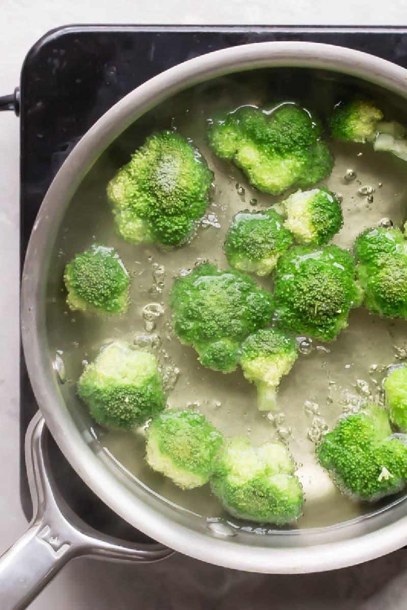 Broccoli blanching in a saucepan.