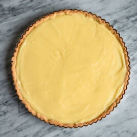 A tart crust filled with pastry cream.