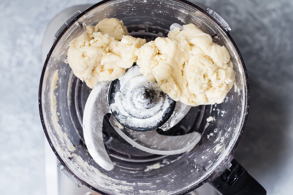 Ingredients for pie crust in a food processor.