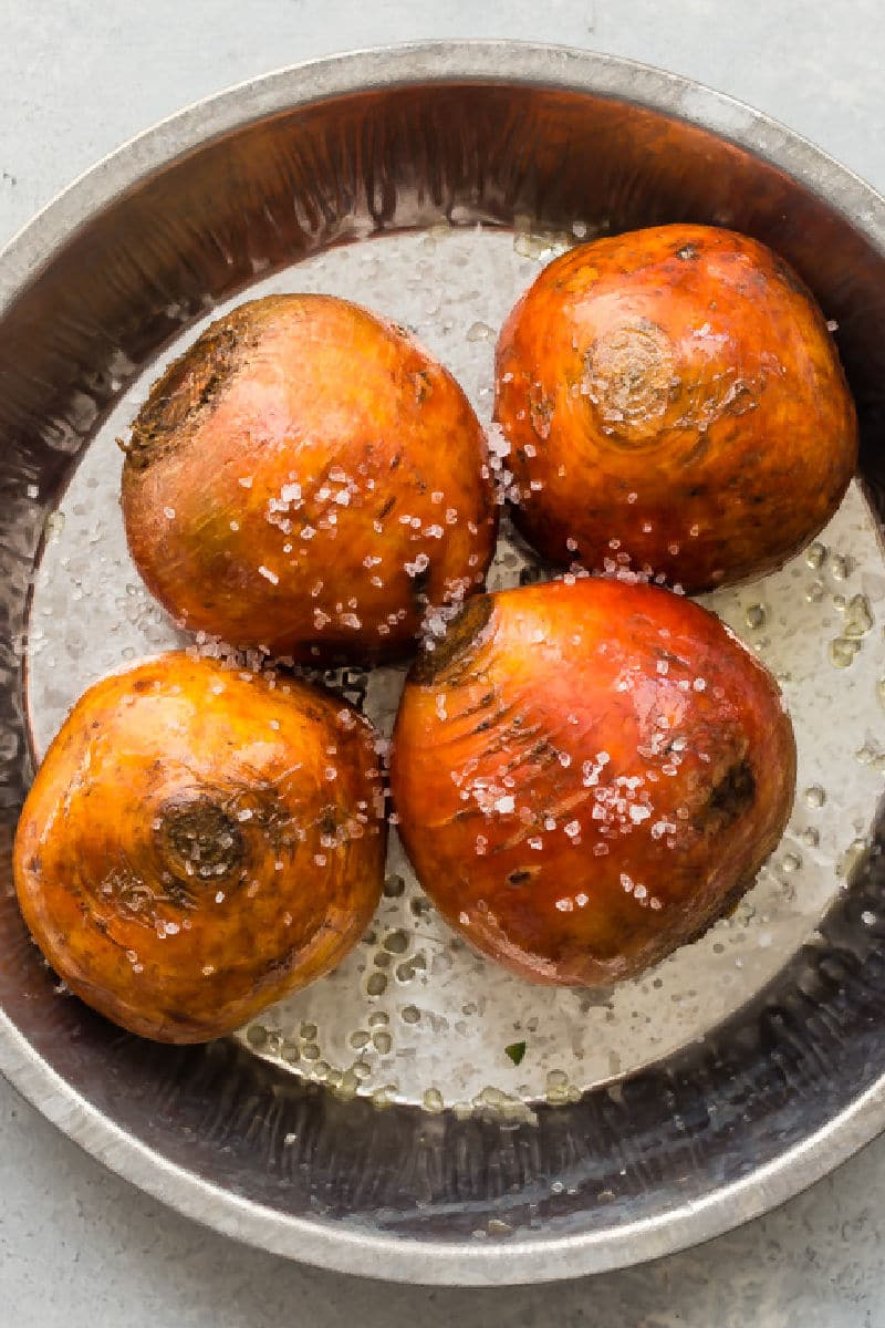 Golden beets in a pan before roasting.