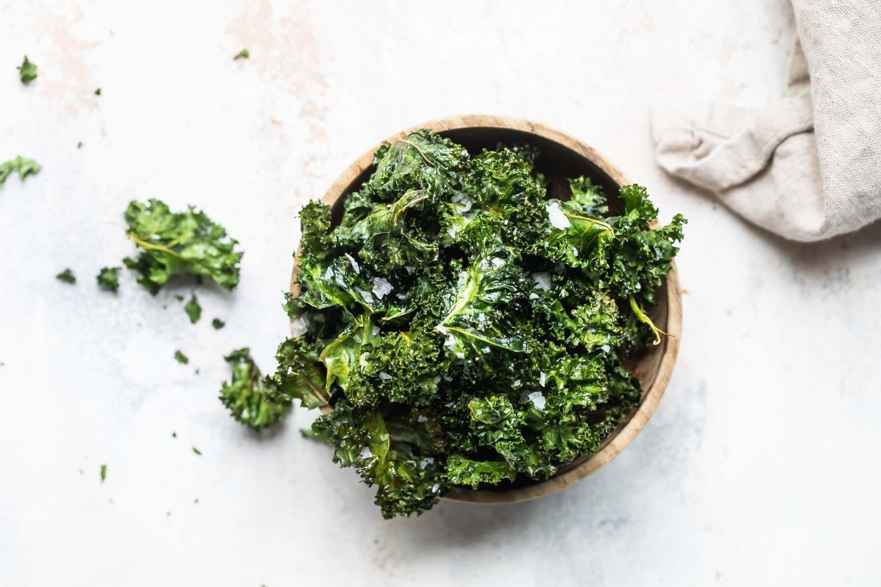 A bowl of baked kale chips.