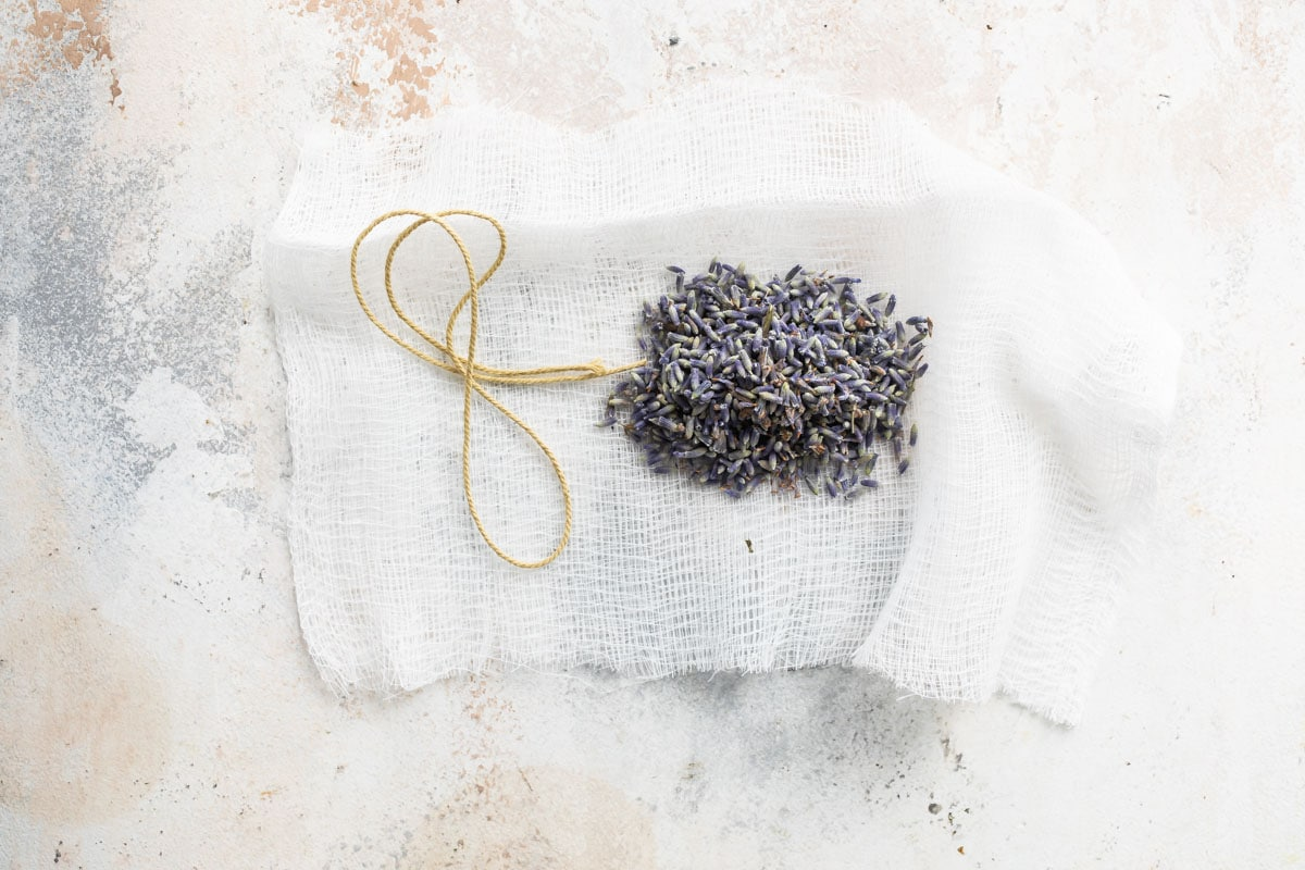 Dried lavender flowers in a piece of cheesecloth.