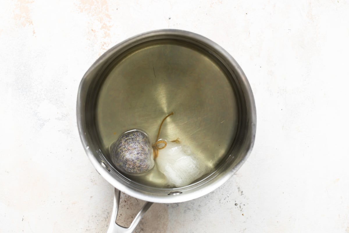 A saucepan with lavender simple syrup.