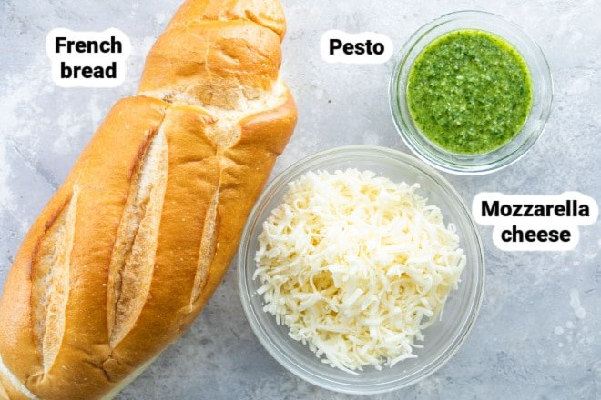 Labeled ingredients for pesto cheese bread.