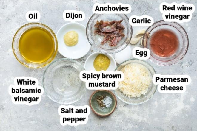 Labeled ingredients for caesar salad dressing.