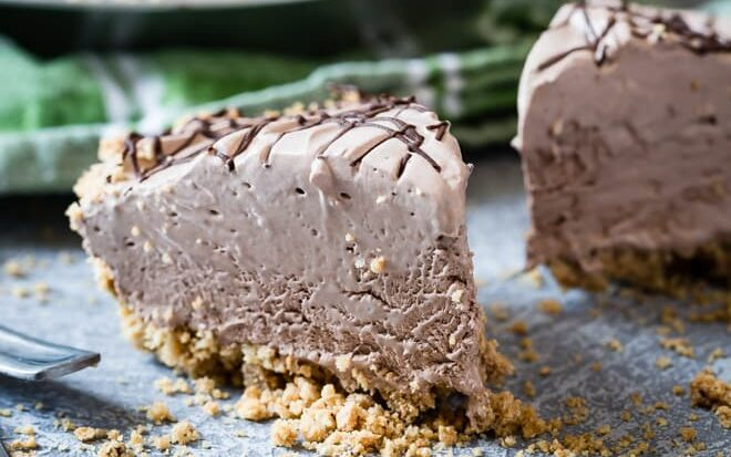 With a homemade graham cracker crust and a creamy, no-bake filling, this frozen Chocolate Cream Pie is the ultimate make-ahead dessert!