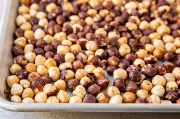 Hazelnuts roasted on a baking sheet.