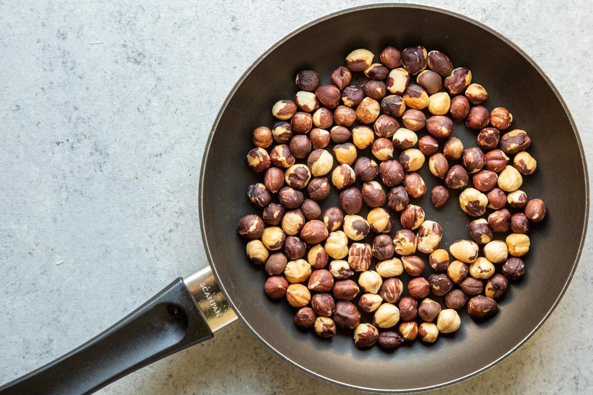 Hazelnuts roasted in a skillet.