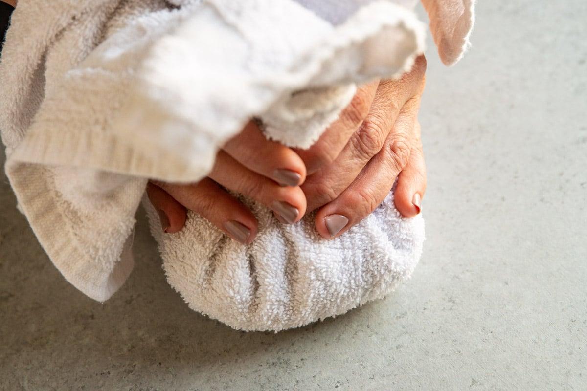 A towel wrapped around roasted hazelnuts to rub off the skins.
