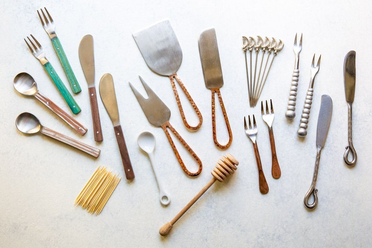 A collection of tools and utensils for charcuterie display.