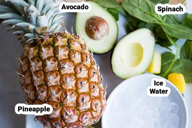 Pineapple spinach smoothie ingredients labeled.