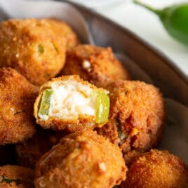 A bowl of jalapeño poppers filled with cream cheese.