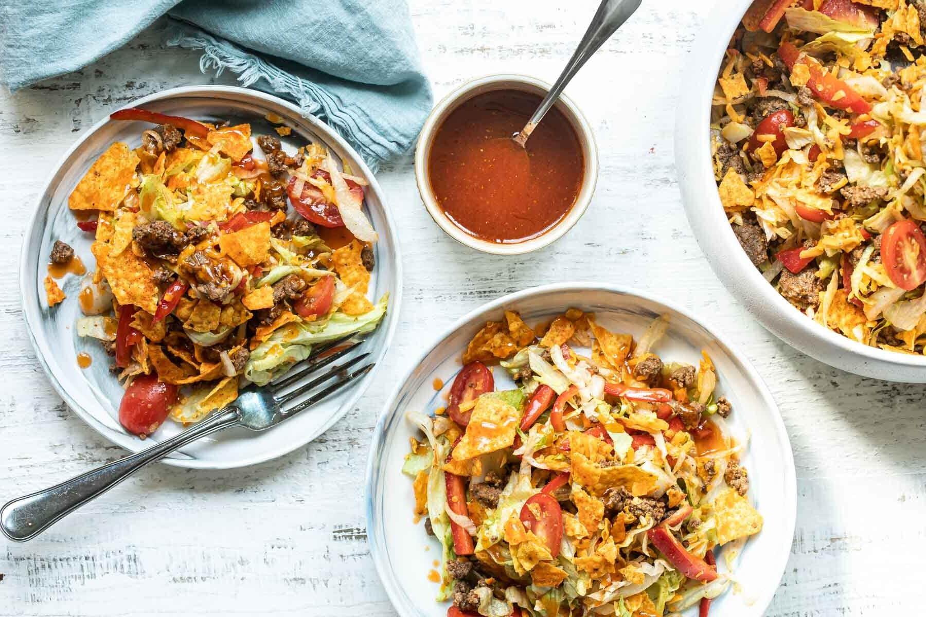 Two bowls filled with Dorito Taco Salad.