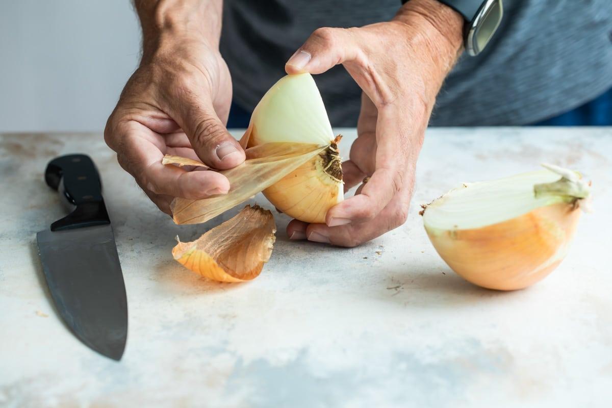 Peeling half an onion.