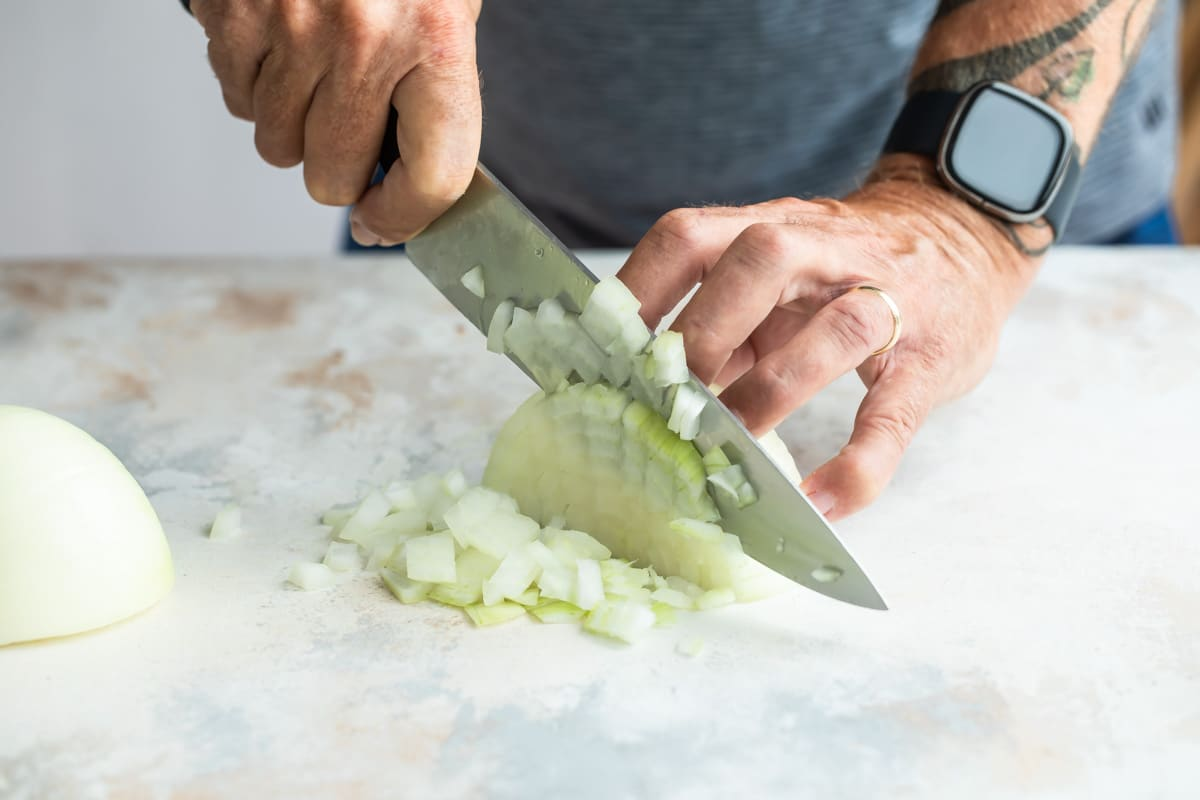 Dicing an onion.