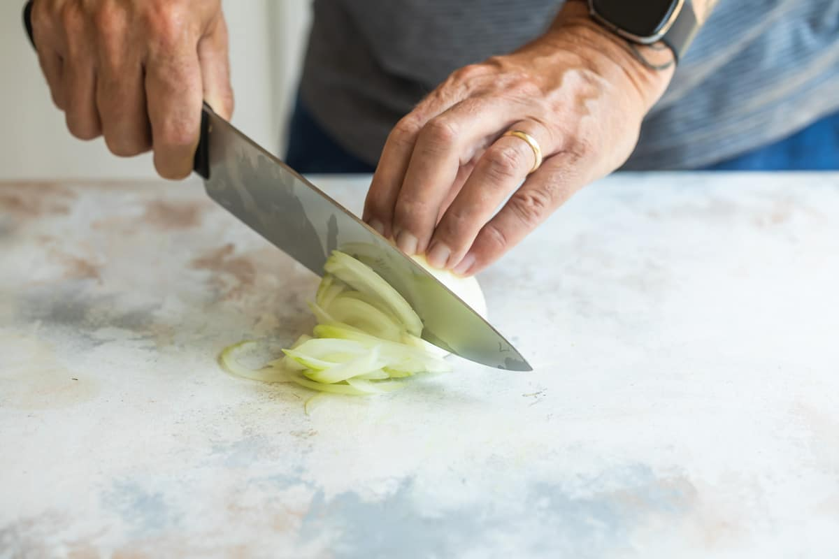Slicing an onion.