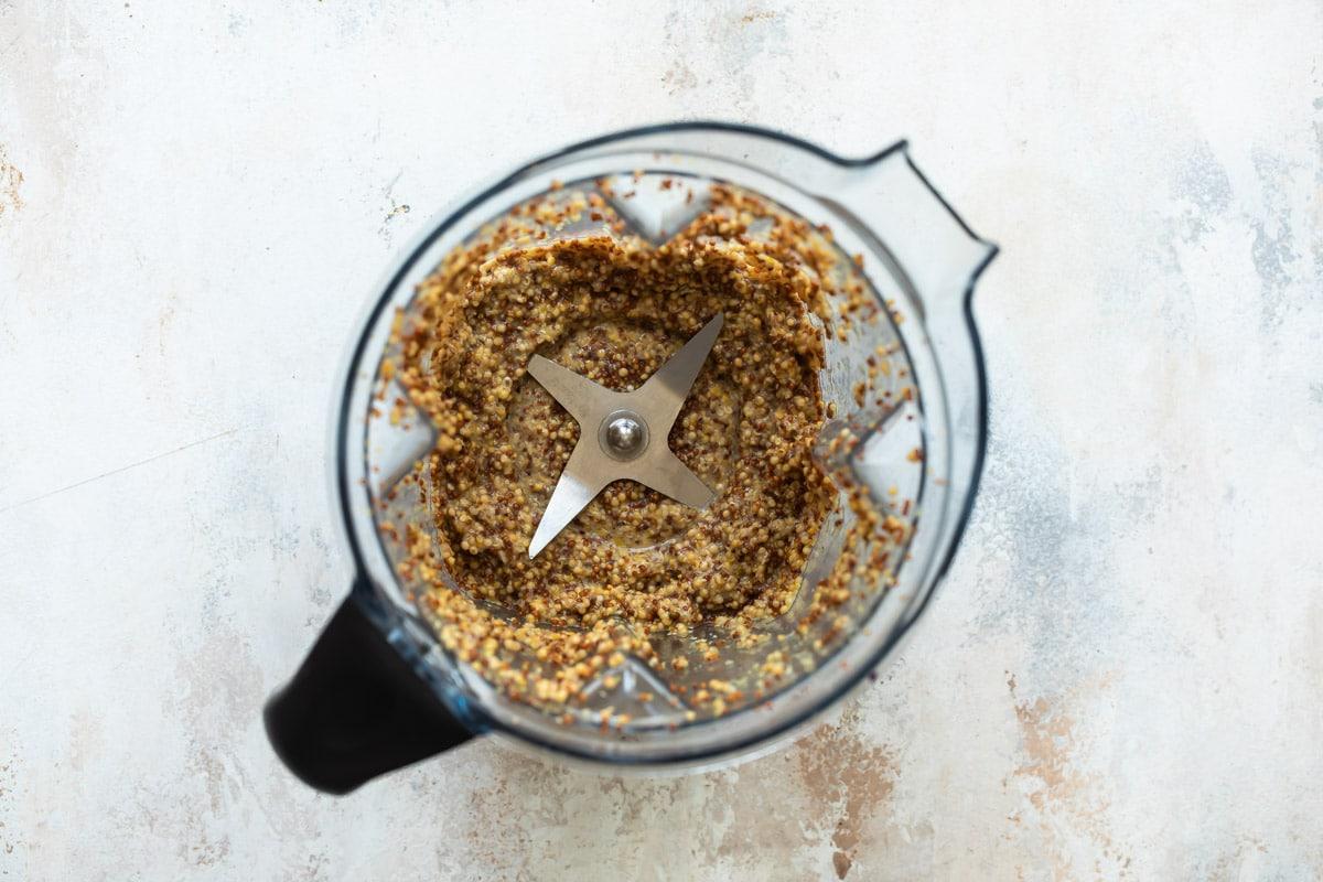 Whole grain mustard in a blender.