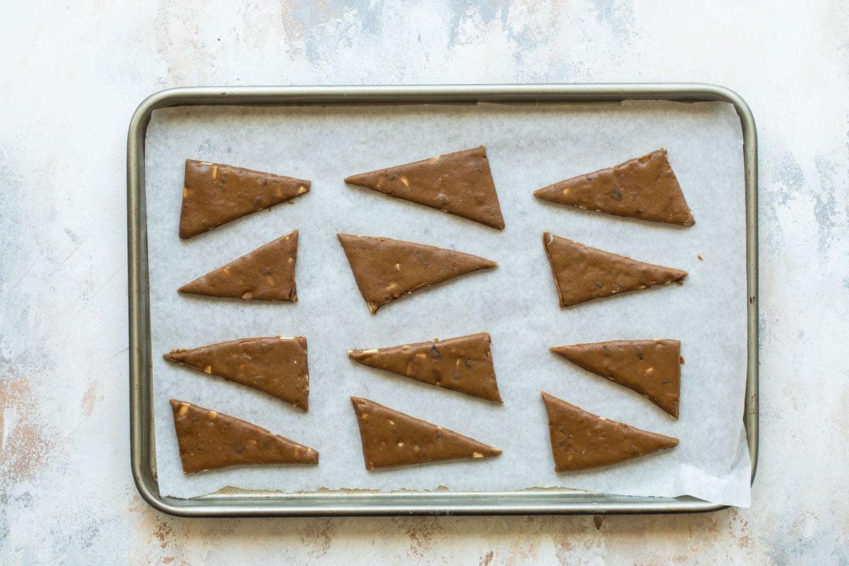 Lebkuchen cookies on a baking sheet before baking.
