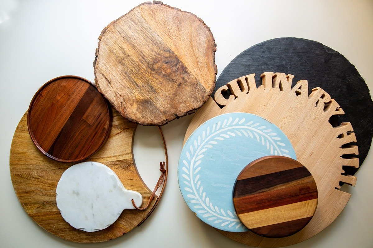 A collection of boards and platters for charcuterie display.