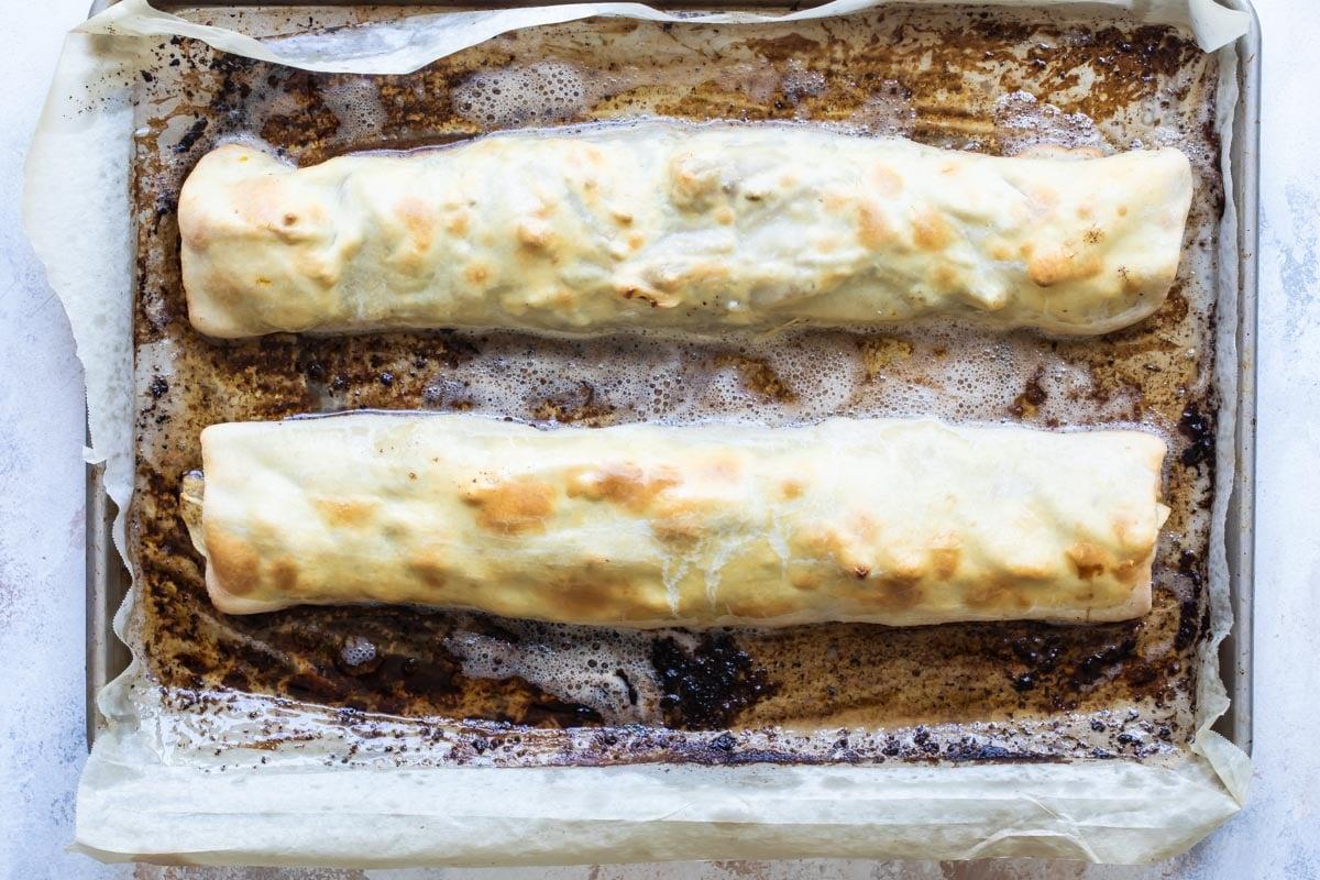 Baked strudels on a baking sheet.