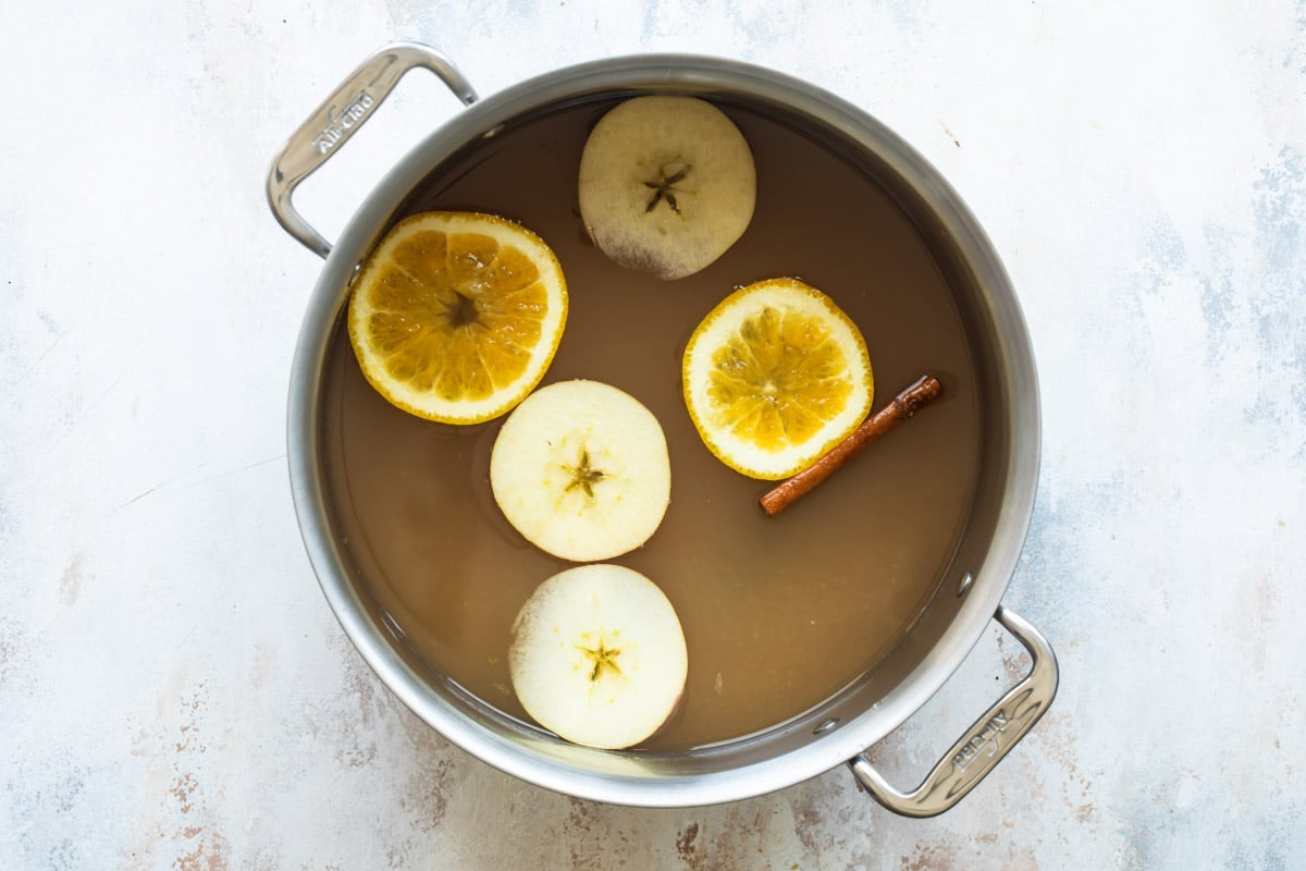 Apple cider in a stock pot.