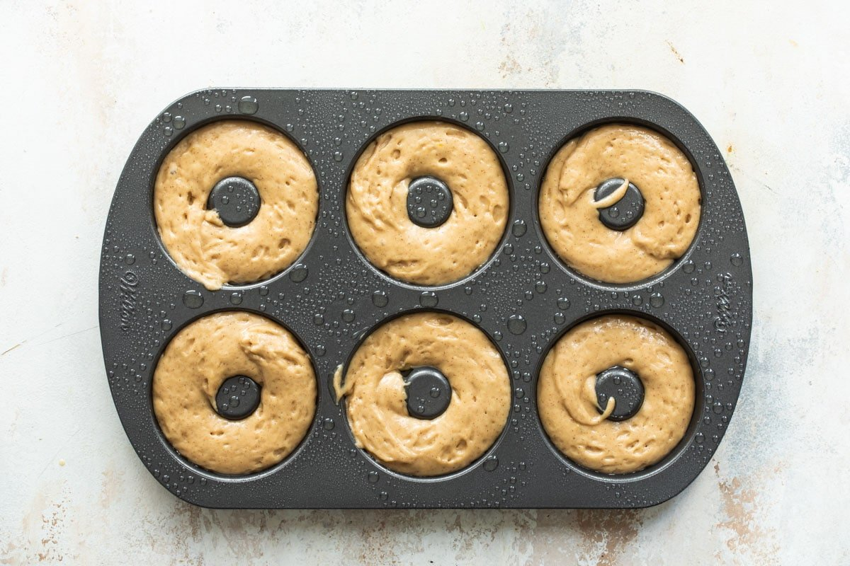 Donut batter for six donuts in a donut pan.