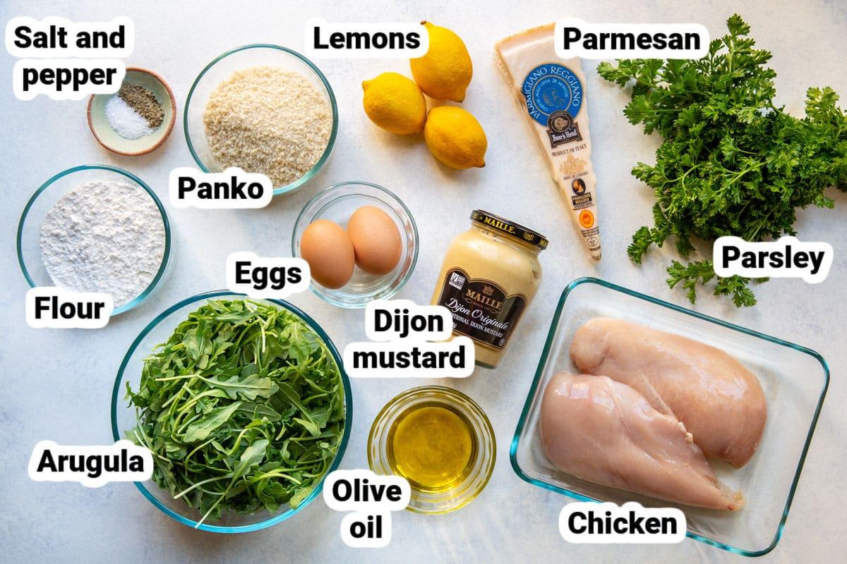 Chicken milanese ingredients in bowls.