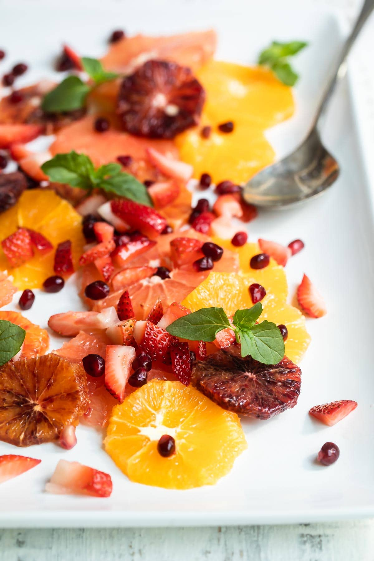 Citrus salad on a white plate.