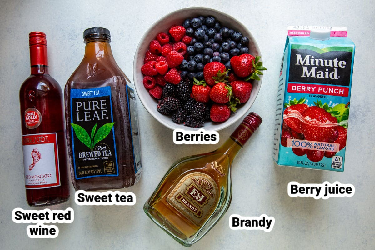 Labeled ingredients for iced tea berry sangria.