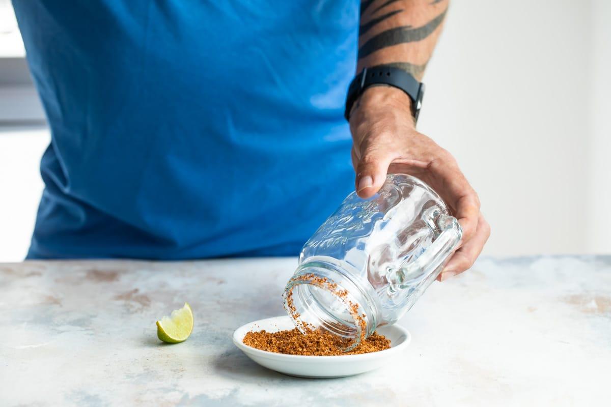 Rimming a glass with tajin for Micheladas.