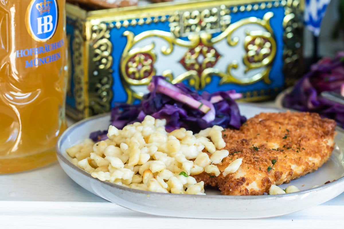 A plate of schnitzel, spaetzle, and braised red cabbage.